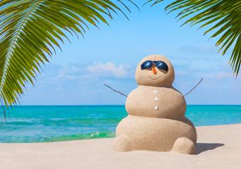 White Snowman Sunbathing Palm Tree On The Beach