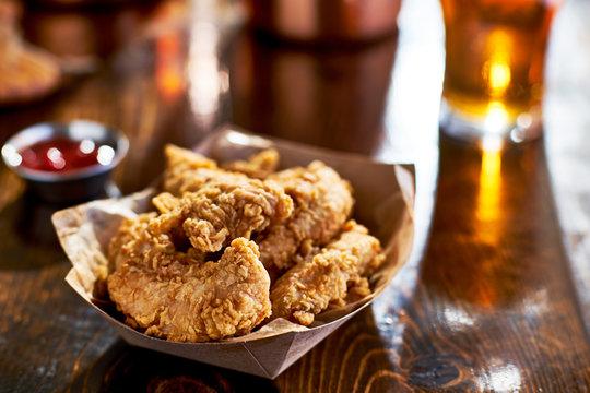 fried chicken tenders in paper basket