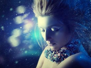 Winter beauty. Fantastic seasonal female portrait with abstract