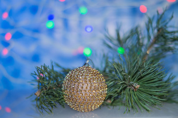 Christmas arrangement with Christmas balls and Christmas tree branch, for Christmas decoration, on colored background, soft focus.