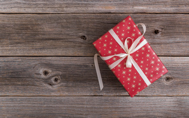 Gift box on a wooden background.