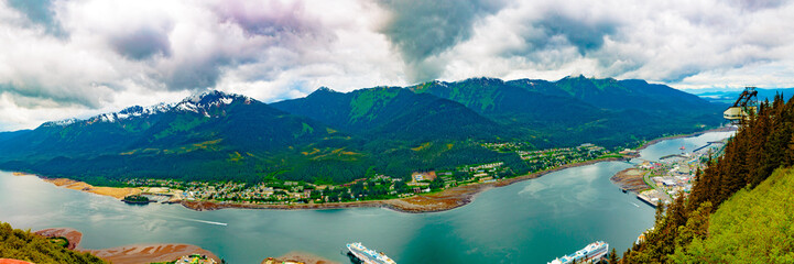 Juneau, Alaska, USA - May 25, 2106:  Panorama of the Gastineau Channel, Juneau cruise ship docks, Mt. Roberts Tramway, Douglas, and the surrounding Tongass National Forest.