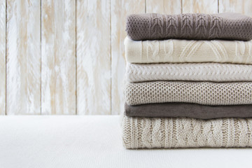 Stack of warm cozy light sweaters