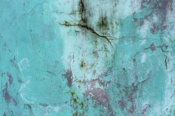 Turquoise wall with cracks