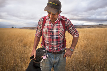 portrait of a working farmer and his dog