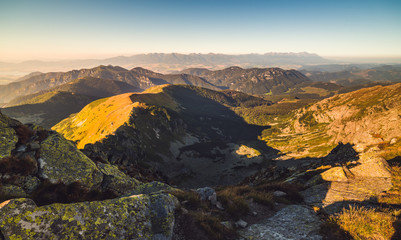 Evening Mountain Landscape with Rocks in Foreground. View from Mount Dumbier in Low Tatras National Park, Slovakia.