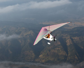 The motor hang-gliding in the sky near the Pokhara - Nepal