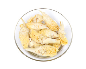 Food of love, marinated artichokes in bowl isolated on white background