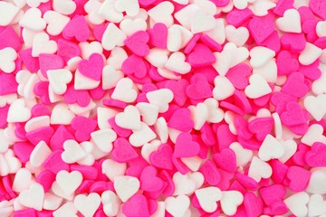 Valentines Day pink and white heart candy sprinkles background