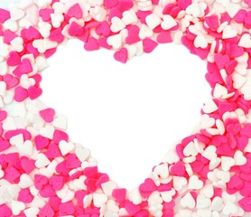 Heart shape within a Valentines Day pink and white candy sprinkles background
