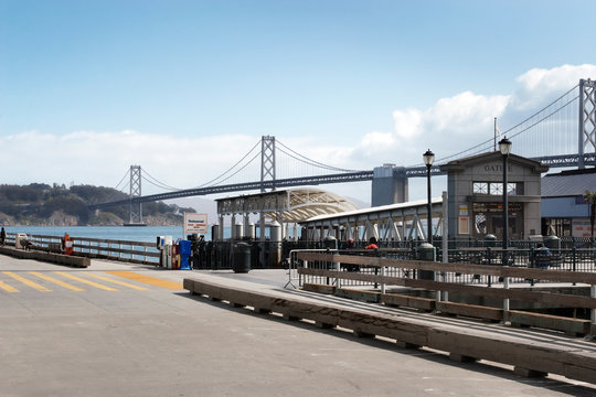 Ferry terminal in San Francisco with Oakland Bay Bridge in the background