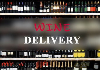 Text WINE DELIVERY on wine bottles background