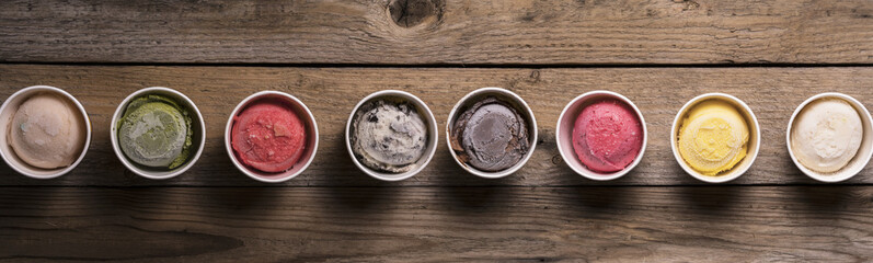 Row of assorted flavors and colors of gourmet Italian ice cream