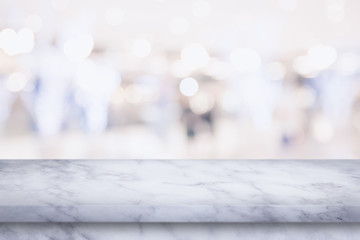 Empty top of marble table with blur shopping mall background.
