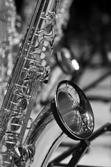 Fototapete - Fragment valves saxophone closeup in black and white