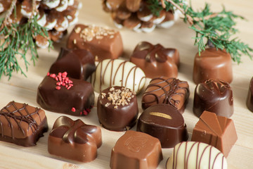lot of variety chocolate pralines on wood background