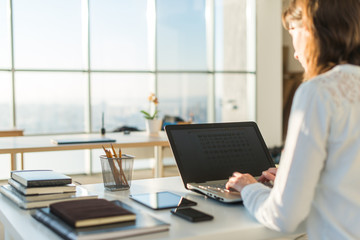 Businesswoman typing on laptop at workplace Woman working in home office hand keyboard