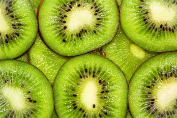 Sliced kiwi. Rings kiwi on a white background. Backlight. Fresh Kiwi pattern / background / back lit. Concept from alfaphoto.