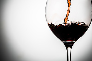 Wine poured into clear goblet on gray background