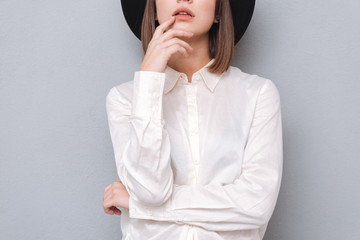 Young stylish woman in hat and shirt posing Wall mural