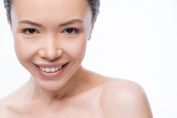 Smiling Korean woman expressing positive emotions in the studio