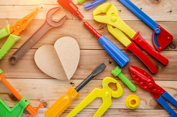 heart shape paper cut with toys tool concept of love problem