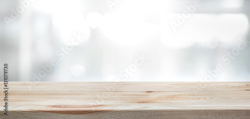 Wood Table Top On Blur Glass Window Wall Building Background.