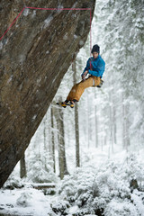 Unique winter sports. Rock climber on a challenging ascent. Extreeme climbing.