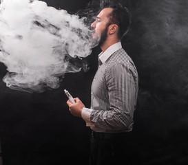 man smoking electronic cigarette vaponizer