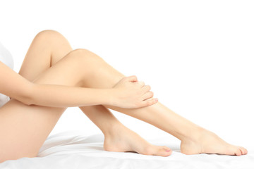 Beautiful female legs on a white background.