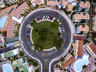 Aerial view of traffic circle and houses