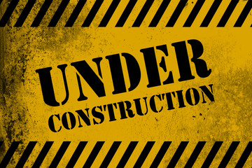 Under construction sign yellow with stripes