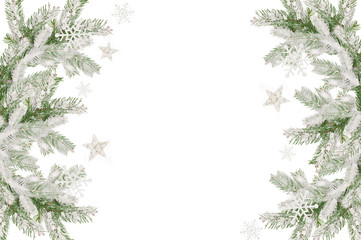 Christmas frame of snow-covered fir branches and place for text