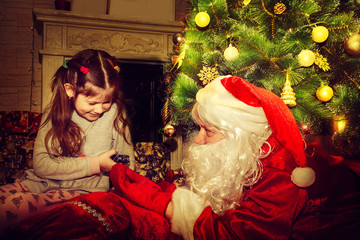 Santa Claus and little girl.