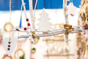 Christmas white figurines icons signs on ropes. Tree, heart, star, wood, cinnamon