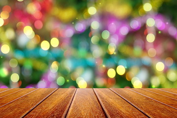 perspective wooden background with colorful Christmas and New year bokeh light