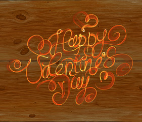 Happy Valentines day vintage lettering written by fire or orange smoke over wooden background