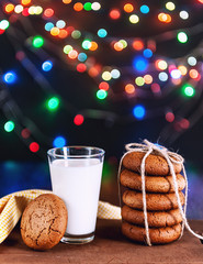 cookies with milk on a wooden table