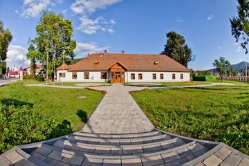 Słoneczny letni dzień w górskim mieście Muszyna. Dworek Starostów. Sunny summer day in the mountain in Muszyna - Poland.