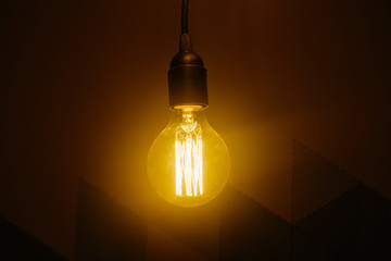 A warm yellow glare of bulb.