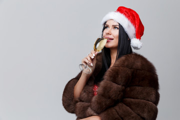 Woman in fur coat and wine