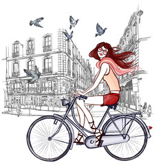 woman riding a bicycle in Paris