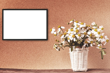 Blank white frame mockup with chamomile flowers in bamboo basket