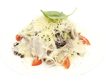 Meat salad with cheese and herbs on a white plate