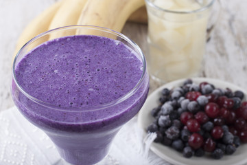Smoothie of banana, canned pineapple, frozen cranberries and blueberries with yogurt