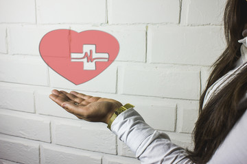 in the palm of the human heart and the red cross
