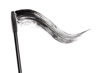 Stroke of black mascara with applicator brush close-up, isolated