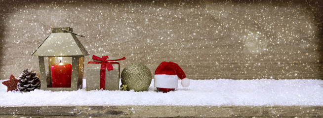 Christmas background with lantern and snow.