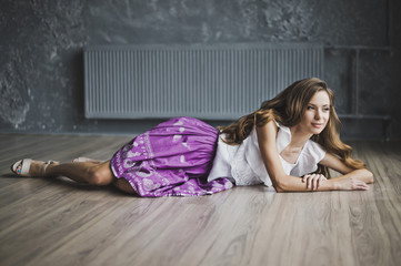 The slender girl lying on the parquet floor 6932.