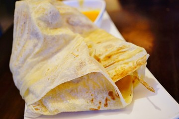 Layered paratha flatbread called Roti Canai in Malaysia